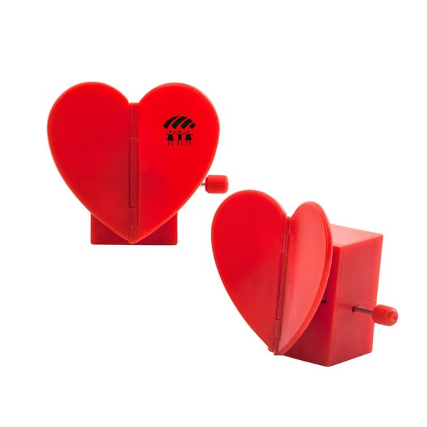 Promotional Kikkerland Wind Up Flapping Heart